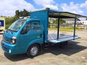 mở-thùng--xe-tải-kia-k200-thùng-kín-cánh-dơi